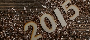 Wooden numbers forming 2015 on a rustic wooden suface